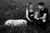 Happy pregnant couple are happy with ultrasound photo of unborn child. Black and white photo. Waiting for child. Pregnancy management. Modern methods of examination.Happy moments.