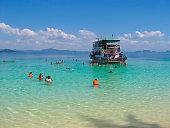 Tourists snorkeling in Andaman sea at Ko Kradan Island, Thailand