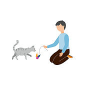 The boy plays with a ball with a gray cat.