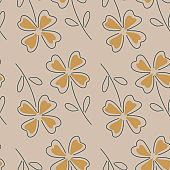 Sketch orange four-leaf clover seamless pattern in simple style. Pale lilac background. Simple print.
