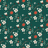 Vintage seamless pattern with doodle flowers and leaves silhouettes. Green background. Simple design.