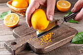 Grater peel and lemon zest on the table