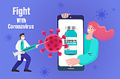 Doctor with big syringe. Book a vaccination queue on your phone. Time to vaccinate. Covid-19. Coronavirus. Fighting the virus. Preventive medicine.