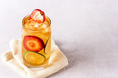 Glasses of Ice Tea with Lime and Strawberry on Gray Background Cold Summer Beverage Horizontal