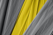 Illuminating and ultimate gray colors crumpled paper background - the fashionable colors of 2021.