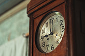 Old wooden clock on the wall