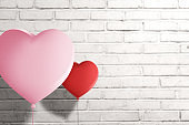 Heart balloon with brick wall background
