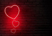 Heart shape from colored neon lights on the wall
