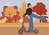 A cute girl in beret and wide leg jeans rides a scooter, lifts her leg and smiles