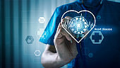 Medical doctor with heart disease healthcare and medical services with AR interface cardiogram illness concept.