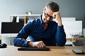 Depressed Sad Young Man With Headache Sitting