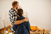 Couple envisioning finished product after renovating their home