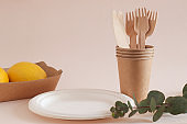 Eco-friendly disposable craft kitchenware. Knives, forks, paper cups and dishes. The concept of zero waste and recycling. Ecology concept