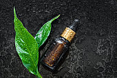 Cosmetic serum dropper and plant leaves