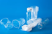 single use plastic cups, forks, spoons. concept of recycling plastic, plastic waste