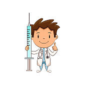 Child doctor holding syringe, happy cute kid