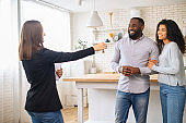 Cute African-American couple in love moving in new house
