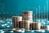 Double exposure of stack rows money coin with trading graph chart stock market. Value exchange and marketing of bank fund economic profit with growth. Finance investment and business concept.