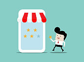 man give stars feedback to store in mobile application social marketing concept