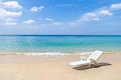 White plastic beach chair on tropical beach
