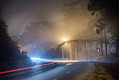 The night view of the pass road is full of fog with magical street lights