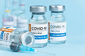 Coronavirus Covid-19 Vaccine vial glass bottles and syringe