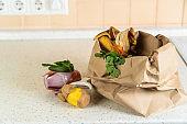 Composting concept - kitchen leftovers in paper bag