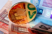 Cryptocurrency ethereum coin on euro bills