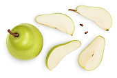 Green pear fruit with slices isolated on white background with clipping path. Top view. Flat lay