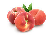 Ripe chinese flat peach fruit with leaf isolated on white background with clipping path and full depth of field