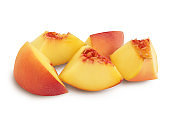 Ripe peach slices isolated on white background with clipping path and full depth of field