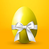 Large egg with a white bow on a yellow background - Vector