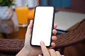female hands holding phone with isolated screen background room