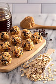 Peanut Butter and Oatmeal Energy Balls with Mini Chocolate Chips Sweetened with Honey