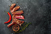 grilled beef steak - tomahawk on a stone background. with copy space for your text