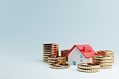 Real estate house and golden coins on blue background. Business mortgage investment and financial loan concept. Money saving and cashflow theme. 3D illustration rendering graphic design