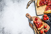 Galette tart with strawberry and rhubarb. Homemade tarte.  White background. Top view. Copy space