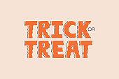 Trick or treat Halloween handwritten lettering text, orange color