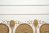Soy on white wooden table, flat lay. Space for text