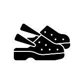 Medical shoes black glyph icon