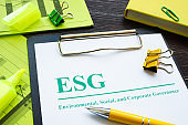Papers about ESG Environmental, Social and Corporate Governance and notepad.