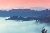 Fantastic view of the tops of the mountain ridge above the clouds