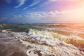 Seascape on a sunny day. Stormy sea with a beautiful cloudy sky. Nature landscape