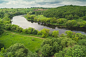 Landscape of a winding river (meandering river) in spring. View from above. Beautiful nature. Europe