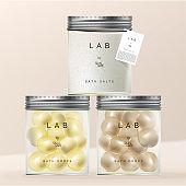 Vector Bath Drops and Salts in Glassware Jar Packaging with Screw Aluminum Cap.