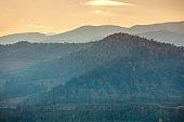 Autumn in the mountains. View of the mountains ridge at sunset. Beautiful nature landscape. Carpathian mountains. Zakarpattia Oblast, Ukraine