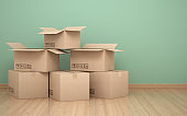 Cardboard boxs in front of the green wall stock photo