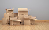 Cardboard boxes in front of gray colored wall stock photo
