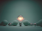 2022 year glowing inside lightbulb among others years for 2022 new business idea concept by 3d rendering technique.