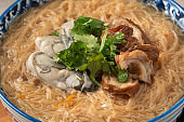 Delicious oyster and intestine vermicelli in a bowl